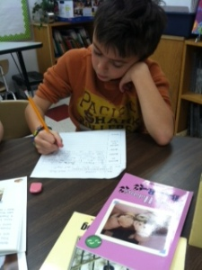 Connor is focused on his writing.
